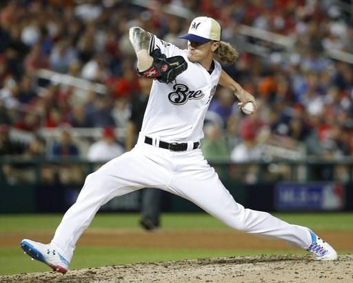 (AP Photo/Alex Brandon). Milwaukee Brewers pitcher Josh Hader (71) throws during the eighth inning at the Major League Baseball All-star Game, Tuesday, July 17, 2018 in Washington.