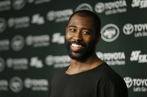(AP Photo/Seth Wenig, File). FILE - In this Aug. 11, 2015, file photo, New York Jets' Darrelle Revis speaks to the media after a Jets practice in Florham Park, N.J.  Revis, a star cornerback with the New York Jets and a Super Bowl winner with their arc...