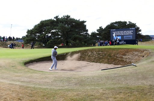 (AP Photo/Jon Super). Tiger Woods of the US plays out of a bunker on the 13th hole during a practice round ahead of the British Open Golf Championship in Carnoustie, Scotland, Wednesday July 18, 2018.