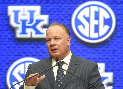 (AP Photo/John Amis). Kentucky head coach Mark Stoops speaks during NCAA college football Southeastern Conference media days at the College Football Hall of Fame in Atlanta, Monday, July 16, 2018.