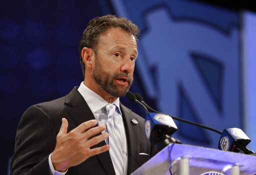 (AP Photo/Chuck Burton). North Carolina head coach Larry Fedora answers a question during a news conference at the NCAA Atlantic Coast Conference college football media day in Charlotte, N.C., Wednesday, July 18, 2018.