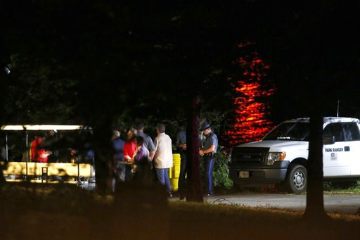 (Andrew Jansen/The Springfield News-Leader via AP). Rescue crews work at the scene of a deadly boat accident at Table Rock Lake in Branson, Mo., Thursday, July 19, 2018. A sheriff in Missouri said a tourist boat has apparently capsized on the lake, lea...