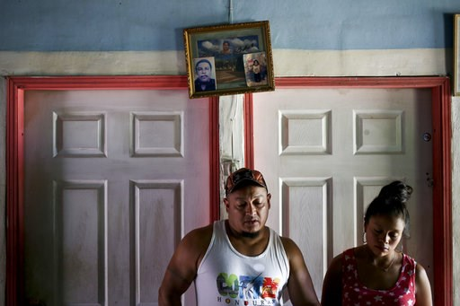 (AP Photo/Esteban Felix). In this July 18, 2018 photo, Rolando Bueso Castillo and his wife Adalicia Montecinos, stand in their home in La Libertad, Honduras. It's been five months since they have seen their infant son Johan Bueso Castillo who was separ...