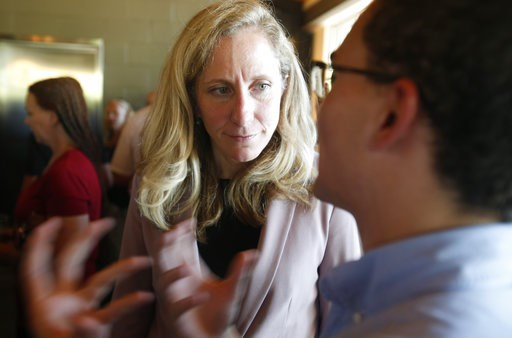 (AP Photo/Steve Helber). Former CIA officer and Democratic candidate for the 7th district Congressional seat, Abigail Spanberger, left, listens to a supporter after a rally in Richmond, Va., Wednesday, July 18, 2018.  Opposition to President Donald Tru...