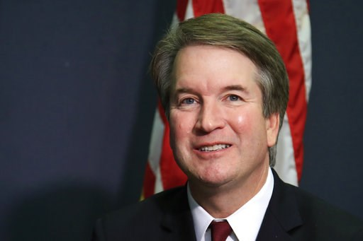 (AP Photo/Manuel Balce Ceneta). In this July 19, 2018, photo, Supreme Court nominee Brett Kavanaugh glances at reporters during a meeting with Sen. James Lankford, R-Okla., on Capitol Hill in Washington. Kavanaugh has a long record of judicial and exec...