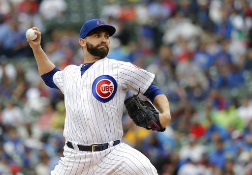 (AP Photo/Charles Rex Arbogast). Chicago Cubs starting pitcher Tyler Chatwood delivers during the first inning of a baseball game against the Chicago Cubs Saturday, July 21, 2018, in Chicago.