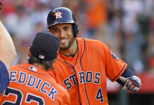 (AP Photo/Mark J. Terrill). Houston Astros' George Springer, right, is congratulated by Josh Reddick after hitting a grand slam during the sixth inning of a baseball game against the Los Angeles Angels, Saturday, July 21, 2018, in Anaheim, Calif. Reddi...