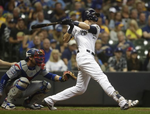 (AP Photo/Morry Gash). Milwaukee Brewers' Christian Yelich hits a home run during the sixth inning of a baseball game against the Los Angeles Dodgers Saturday, July 21, 2018, in Milwaukee.