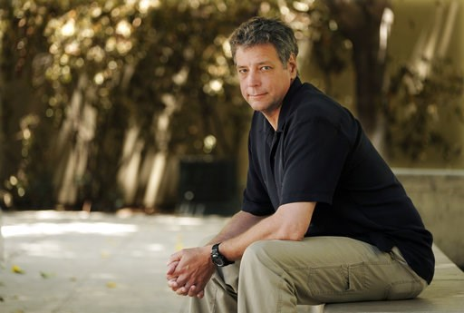 """(AP Photo/Chris Pizzello). In this June 20, 2018 photo, Michael Scott Moore, author of """"The Desert and the Sea: 977 Days Captive on the Somali Pirate Coast,"""" poses for a portrait at Los Angeles Public Library in Los Angeles. Six and a half years after ..."""