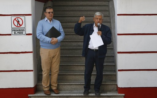 (AP Photo/Marco Ugarte). Mexico's President-elect Andres Manuel Lopez Obrador, right, and his future Foreign Minister, Marcelo Ebrard, speaks to the press outside his party's headquarters in Mexico City, Sunday, July 22, 2018. Lopez Obrador has release...