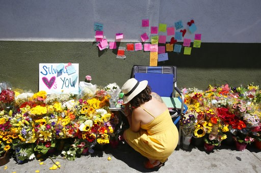 (AP Photo/Damian Dovarganes). A makeshift memorial of flowers, candles and notes grows on the sidewalk outside the Los Feliz Trader Joe's store in Los Angeles, Sunday, July 22, 2018. A day earlier, Trader Joe's employee Melyda Corado was shot and kille...