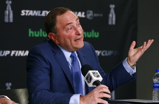 (AP Photo/Ross D. Franklin, file). FILE - In this May 28, 2018 file photo NHL Commissioner Gary Bettman speaks during a news conference prior to Game 1 of the NHL Stanley Cup Final hockey game between the Vegas Golden Knights and the Washington Capital...