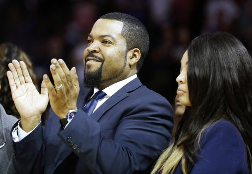(AP Photo/Kathy Willens, file). FILE - In this June 25, 2017 file photo Big3 Basketball League founder Ice Cube applauds the crowd during a timeout in the first half of Game 2 in the league's debut at the Barclays Center in New York. Ice Cube tips off ...