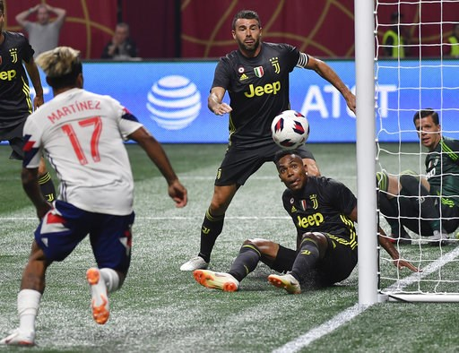 (AP Photo/John Amis). MLS All-Star forward Josef Martinez (17) goes for the ball against Juventus goalkeeper Wojciech Szczesny, right, during the MLS All-Star soccer match, Wednesday, Aug. 1, 2018, in Atlanta.