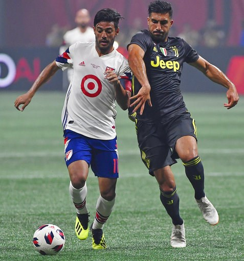 (AP Photo/Mike Stewart). MLS All-Star midfielder Carlos Vela (11) and Juventus midfielder Emre Can (23) vie for the ball during the first half of the MLS All-Star soccer match, Wednesday, Aug. 1, 2018, in Atlanta.