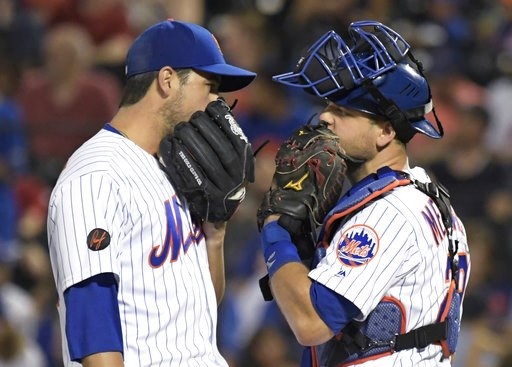 (AP Photo/Bill Kostroun). New York Mets relief pitcher Anthony Swarzak, left, talks with catcher Devin Mesoraco during the ninth inning of the team's baseball game against the Atlanta Braves on Friday, Aug. 3, 2018 in New York.the Braves won 2-1.