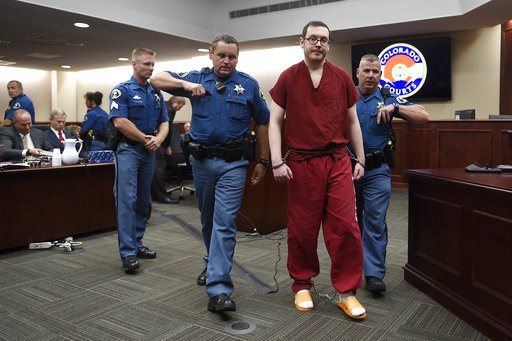 (RJ Sangosti/The Denver Post via AP, Pool, File). FILE - In this Aug. 26, 2015, file photo, Colorado theater shooter James Holmes, right, is led out of the courtroom after being formally sentenced in Centennial, Colo., to serve life in prison without p...