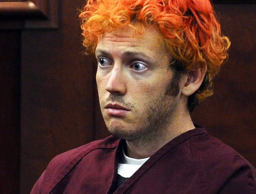 (RJ Sangosti/The Denver Post via AP, Pool, File). FILE - In this July 23, 2012, file photo, James Holmes, who was convicted of killing 12 moviegoers and wounding 70 more in a shooting spree in a crowded theatre in 2012, sits in Arapahoe County District...