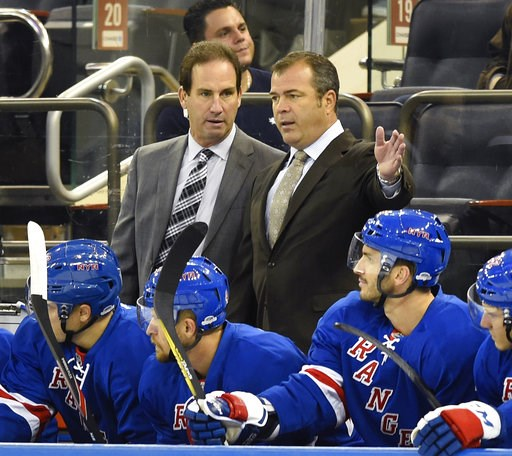 (AP Photo/Kathy Kmonicek, File). FILE - In this Sept. 19, 2016, file photo, New York Rangers associate coach Scott Arniel, left, and head coach Alain Vigneault talks in the first period of a preseason NHL hockey game in New York. The Washington Capital...