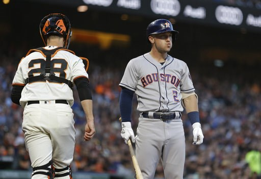 (AP Photo/Eric Risberg). Houston Astros' Alex Bregman reacts after striking out looking against San Francisco Giants starting pitcher Dereck Rodriguez in the third inning of a baseball game Monday, Aug. 6, 2018, in San Francisco. At left is Giants' cat...