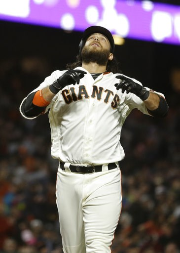 (AP Photo/Eric Risberg). San Francisco Giants' Brandon Crawford looks upward before crossing home plate after hitting a home run off Houston Astros starting pitcher Charlie Morton in the sixth inning of a baseball game Monday, Aug. 6, 2018, in San Fran...