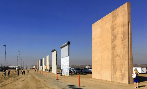 (AP Photo/Elliott Spagat, File). FILE - This Oct. 26, 2017 file photo shows prototypes of border walls in San Diego. A federal appeals court will hear arguments by the state of California that the Trump administration overreached by waiving environment...