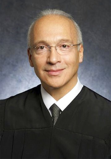 (U.S. District Court via AP, File). FILE - This undated photo provided by the U.S. District Court shows Judge Gonzalo Curiel. A federal appeals court will hear arguments Tuesday, Aug. 7, 2018, by the state of California and advocacy groups who contend ...