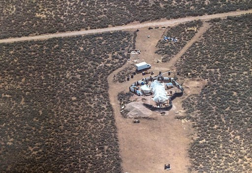 (Taos County Sheriff's Office via AP, File). FILE - This Aug. 3, 2018, file photo released by Taos County Sheriff's Office shows a rural compound during an unsuccessful search for a missing boy in Amalia, N.M. Three women believed to be the mothers of ...