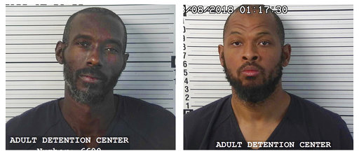 (Taos County Sheriff's Department via AP). CORRECTS LAST NAME TO MORTON, NOT MORTEN - This photo provided by the Taos County Sheriff's Department shows Lucas Morton, left, and Siraj Wahhaj. Morton and Wahhaj were arrested after law enforcement officers...