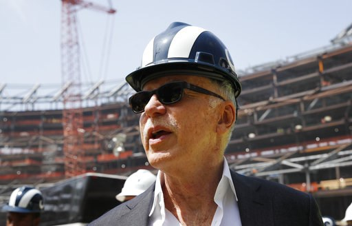 (AP Photo/Jae C. Hong). FILE - In this file photo dated Thursday, June 14, 2018, Los Angeles Rams owner Stan Kroenke tours the team's new NFL football stadium, in Inglewood, Calif. USA.  In a statement published Tuesday Aug. 7, 2018, majority sharehold...
