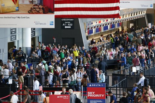 (AP Photo/Michael Dwyer, File). FILE- In this June 29, 2018, photo passengers wait to pass through security at Logan International Airport in Boston. As summer vacationers start to pack up and head home, Congress is considering a sweeping tally of prop...
