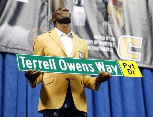 (AP Photo/Mark Humphrey). Former wide receiver Terrell Owens holds a street sign after a road was named for him following his Pro Football Hall of Fame speech, Saturday, Aug. 4, 2018, in Chattanooga, Tenn. Instead of speaking at the Hall of Fame events...