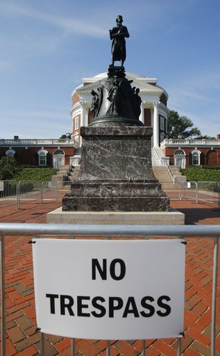 (AP Photo/Steve Helber). In this Monday, Aug. 6, 2018 photo, a statue of Thomas Jefferson is surrounded by fencing and a No Trespassing sign in front of the rotunda on the campus of the University of Virginia in Charlottesville, Va. The statue was the ...