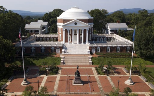 (AP Photo/Steve Helber). In this Monday, Aug. 6, 2018 photo, statue of Thomas Jefferson is surrounded by fencing and a No Trespassing sign in front of the rotunda on the campus of the University of Virginia in Charlottesville, Va. The statue was the fo...