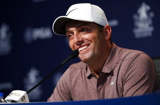 (AP Photo/Jeff Roberson). Francesco Molinari, of Italy, smiles as he listens to a question during a news conference at the PGA Championship golf tournament Tuesday, Aug. 7, 2018, at Bellerive Country Club in St. Louis.