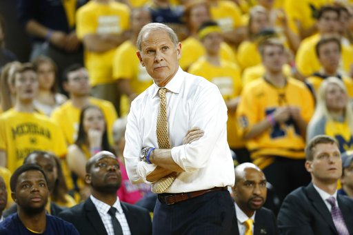 (AP Photo/Paul Sancya, File). FILE- In a Dec. 2, 2017, file photo, Michigan head coach John Beilein watches during the first half of an NCAA basketball game against the Indiana in Ann Arbor, Mich. Coach Beilein has undergone a double-bypass heart proce...
