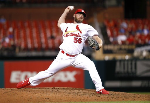 (AP Photo/Jeff Roberson, File). FILE- In this June 26, 2018, file photo, St. Louis Cardinals relief pitcher Greg Holland throws during the eighth inning of a baseball game against the Cleveland Indians in St. Louis. The Washington Nationals have signed...