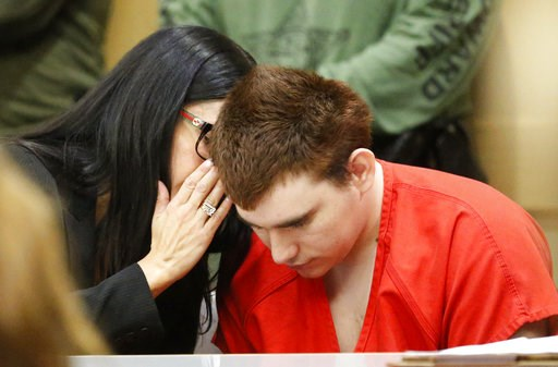 (AP Photo/Wilfredo Lee, Pool). Assistant Public Defender Erin Veit, left, talks with school shooting suspect Nikolas Cruz sits in a Broward County courtroom for a hearing in Fort Lauderdale, Fla., Friday, Aug. 3, 2018. Attorneys for Cruz want a judge t...