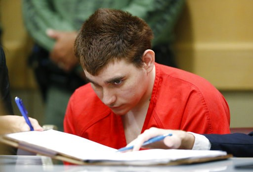 (AP Photo/Wilfredo Lee, Pool). School shooting suspect Nikolas Cruz sits in a Broward County courtroom for a hearing in Fort Lauderdale, Fla., Friday, Aug. 3, 2018. Attorneys for Cruz want a judge to prevent release of details of his education records ...