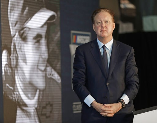 (AP Photo/Chuck Burton, File). FILE - In this May 23, 2018, file photo, NASCAR Chairman Brian France watches a video of driver Jeff Gordon after after announcing Gordon will be inducted into the 2019 class of the NASCAR Hall of Fame, in Charlotte, N.C....