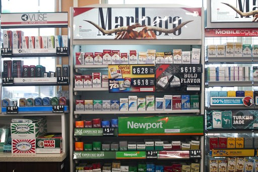 (AP Photo/Bobby Caina Calvan, File). FILE - In this May 18, 2017 file photo, packs of cigarettes are offered for sale at a convenience store in Helena, Mont. A tobacco industry-funded group is asking the Montana Supreme Court to re-phrase a ballot init...