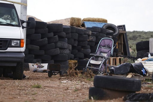 (Jesse Moya/The Taos News via AP). This Aug. 5, 2018 photo shows debris outside the location where people camped near Amalia, N.M. Three women believed to be the mothers of 11 children found hungry and living in a filthy makeshift compound in rural nor...