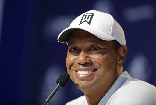 (AP Photo/Darron Cummings). Tiger Woods responds to a question during a news conference at the PGA Championship golf tournament at Bellerive Country Club, Tuesday, Aug. 7, 2018, in St. Louis.