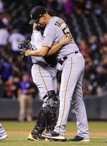 (AP Photo/Jack Dempsey). Pittsburgh Pirates starting pitcher Jameson Taillon hugs catcher Francisco Cervelli after the team's baseball game against the Colorado Rockies, Tuesday, Aug. 7, 2018, in Denver. Taillon threw a complete game and the Pirates de...