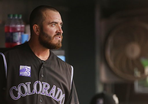 (AP Photo/Jack Dempsey). Colorado Rockies starting pitcher Chad Bettis looks out from the dugout after being pulled during the fifth inning of the team's baseball game against the Pittsburgh Pirates, Tuesday, Aug. 7, 2018, in Denver.