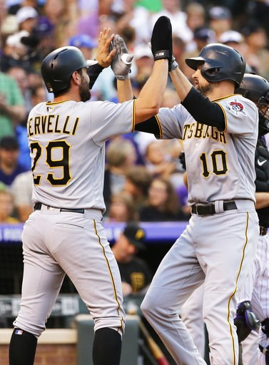 (AP Photo/Jack Dempsey). Pittsburgh Pirates' Jordy Mercer (10) is congratulated by Francisco Cervelli (29) at home plate after hitting a three-run home run off Colorado Rockies starting pitcher Chad Bettis during the fourth inning of a baseball game Tu...