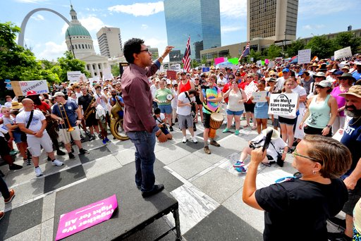 (David Carson/St. Louis Post-Dispatch via AP). In this June 30, 2018, photo, Wesley Bell, a candidate for St. Louis County Prosecuting Attorney, addresses the crowd during a protest about the Trump Administration's policy of family separation and deten...