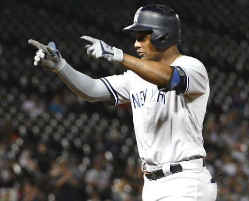 (AP Photo/David Banks). New York Yankees' Miguel Andujar (41) gestures after hitting an RBI  against the Chicago White Sox during the 13th inning of a baseball game Tuesday, Aug. 7, 2018, in Chicago. The Yankees won 4-3 in 13 innings.