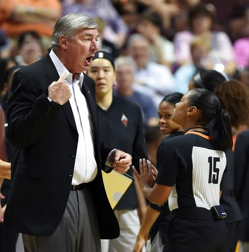 (Sean D. Elliot/The Day via AP, File). FILE - In this Sunday, Aug. 5, 2018, file photo, Las Vegas Aces head coach Bill Laimbeer, left, offers his opinion on a call to official Fatou Cissoko-Stevens during the first half of WNBA basketball game action a...