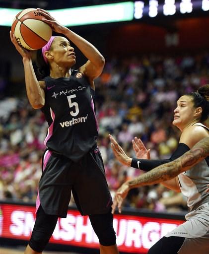 (Sean D. Elliot/The Day via AP). Connecticut Sun guard Jasmine Thomas (5) scores over Las Vegas Aces guard Kayla McBride in the second half of WNBA action Sunday, Aug. 5, 2018 at Mohegan Sun Arena in Uncasville, Conn. The Sun won 109-88.